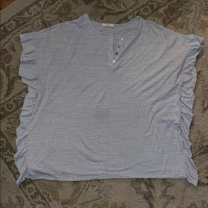 Gray top with ruffle sides with four buttons